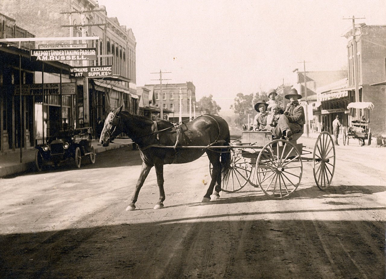 Around 1920 Lake County's residents were transitioning from horse-drawn to motorized travel. Undertaker A.M. Russell, whose establishment is visible on the left, handled many of the funerals for Lake County's victims of the 1918 influenza pandemic. Photo courtesy of Lake County Museum.