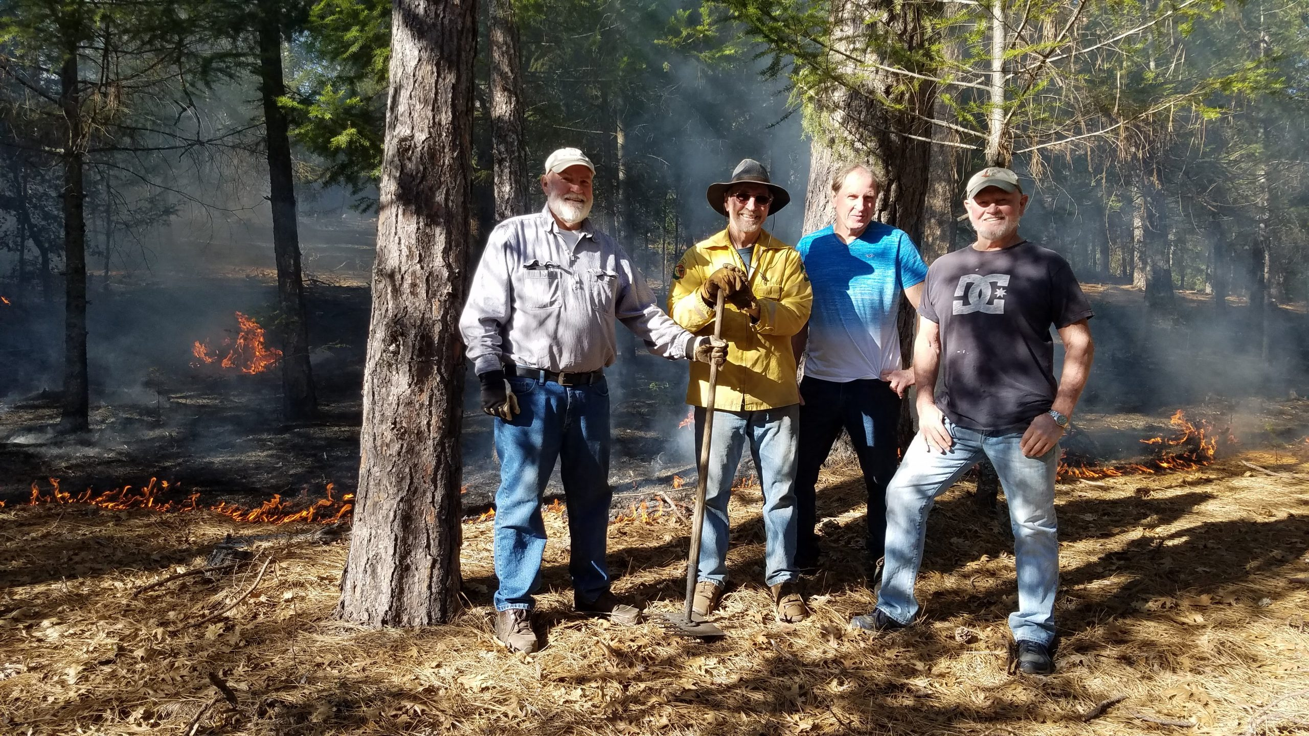 Mike, Gary, Danny, and Steve Prather at a controlled burn on their mountain